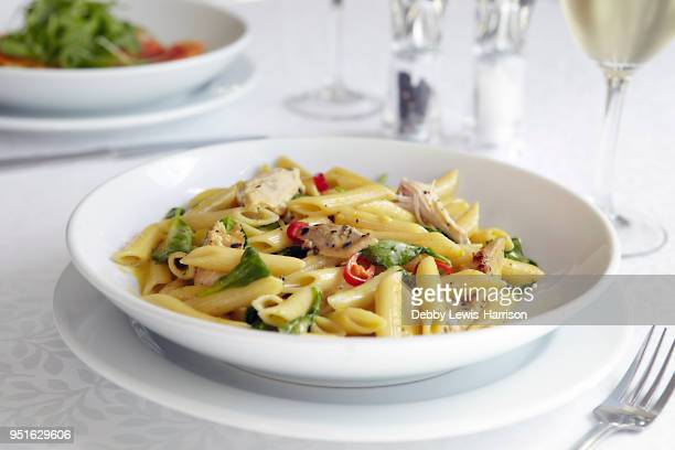 fresh pasta dish in bowl - ready to eat stock pictures, royalty-free photos & images