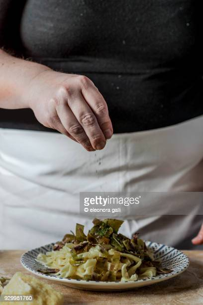 fresh pasta with artichokes - parsley stock pictures, royalty-free photos & images