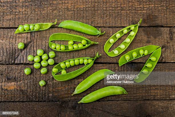 Fresh peas on wooden table