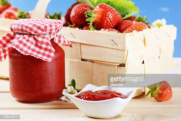 Fresh picked strawberries and strawberry jam