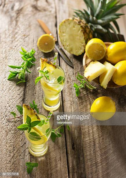 fresh pineapple and lemon juice with fresh mint and basil leaf. - lemon leaf stock photos and pictures