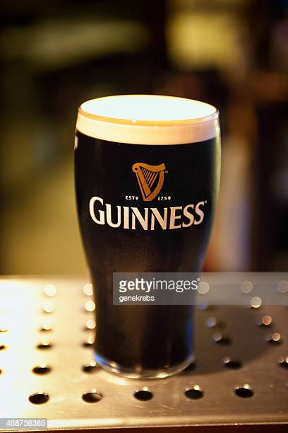 fresh pint of guinness, ballyneale, ireland - guinness stock photos and pictures