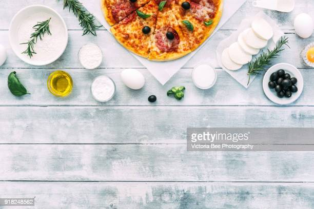 Fresh Pizza on wooden background