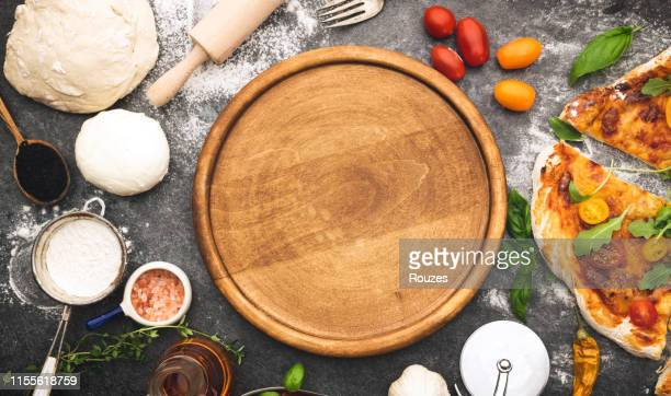 fresh pizza preparing - cutting board stock pictures, royalty-free photos & images