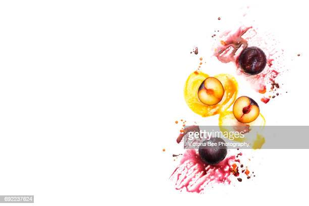 Fresh plum. Creative food shot with watercolor.