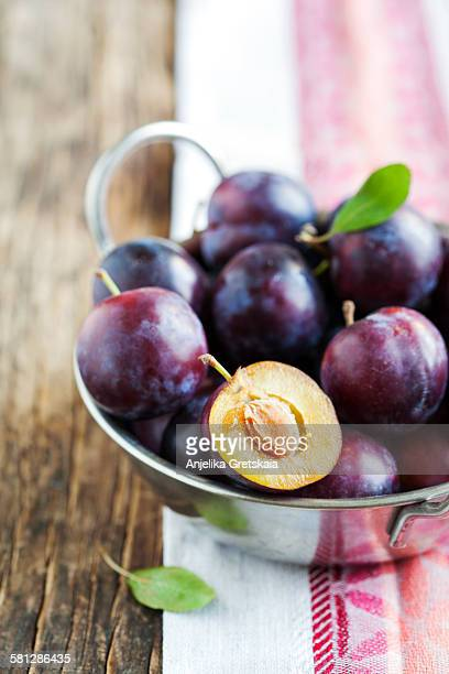 fresh plums in bowl - plum stock pictures, royalty-free photos & images
