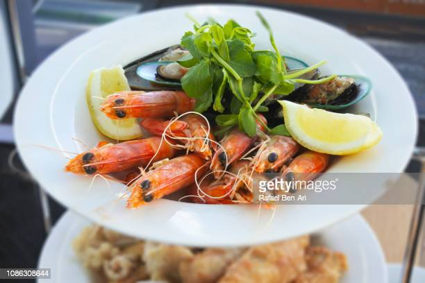 fresh prawns served on a white plate - rafael ben ari stock pictures, royalty-free photos & images