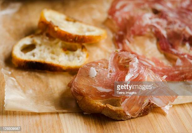 fresh prosciutto ham with bread - charcuterie board stock pictures, royalty-free photos & images