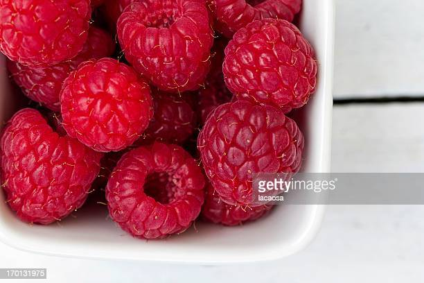Fresh raspberries in a white bowl
