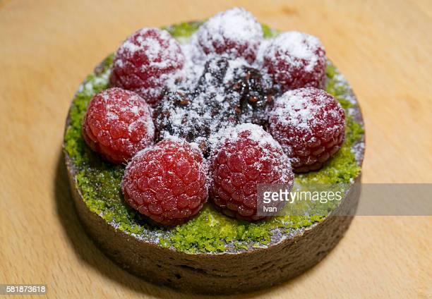 Fresh Raspberry Mini Pie With Pistachio On Wood Plate