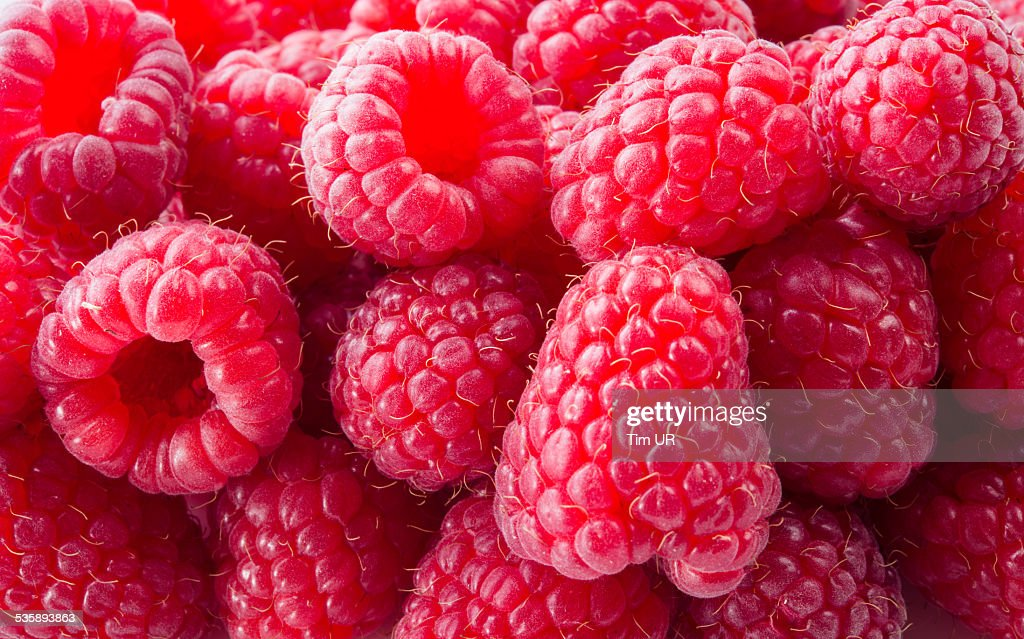 Fresh raspberry. Red background : Stockfoto