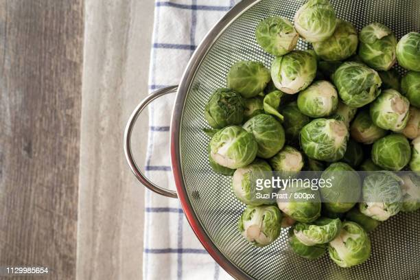 Fresh, Raw Harvest Of Green Brussels Sprouts In A