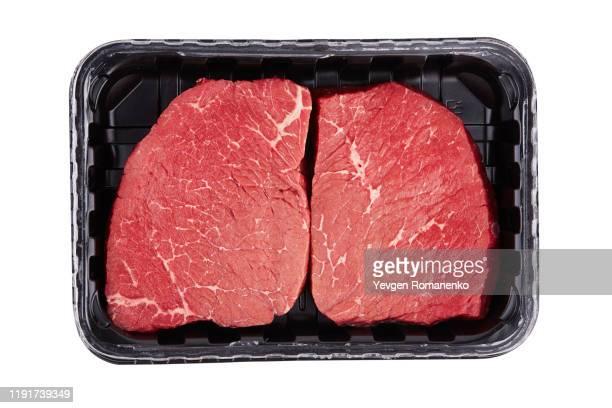 fresh raw meat in package, isolated on white background - fleisch stock-fotos und bilder