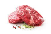 fresh raw rib eye steaks isolated on white