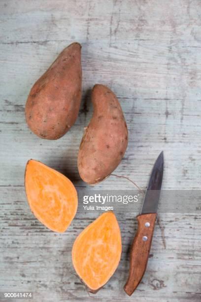 Fresh raw sweet potatoes whole and sliced