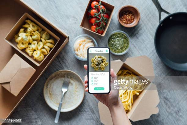 fresh recipe box and food delivery - mobile app stock pictures, royalty-free photos & images