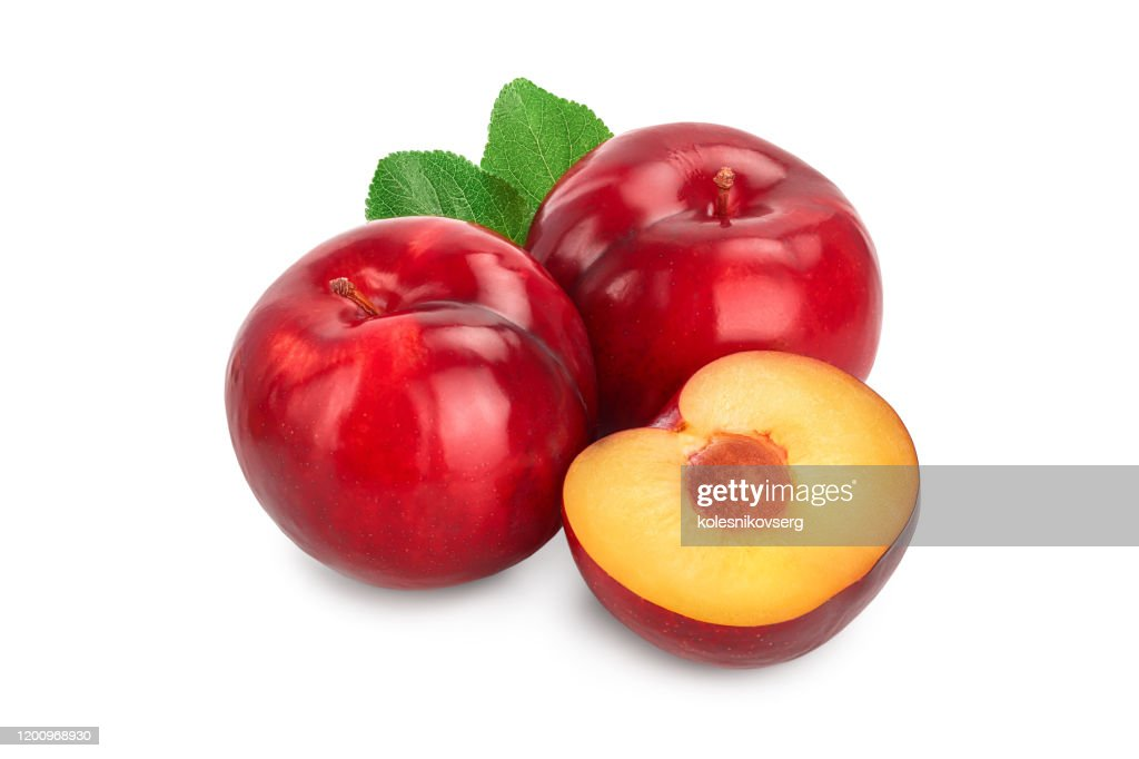 fresh red plum and half with leaves isolated on white background : Stock Photo