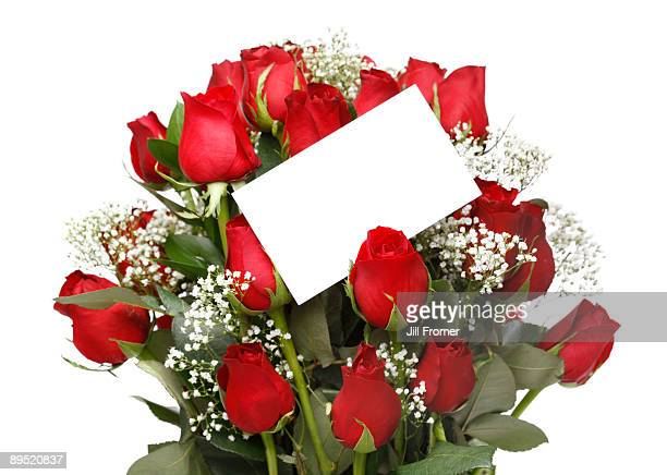 Fresh Red Roses with Blank Note Close-Up