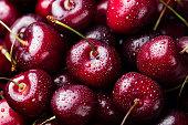 Fresh ripe black cherries background Top view Close up