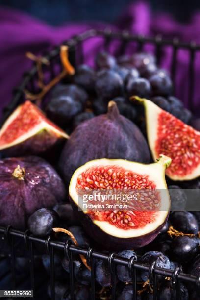 Fresh ripe figs and purple grape