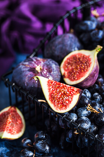 Fresh ripe figs and purple grape - gettyimageskorea