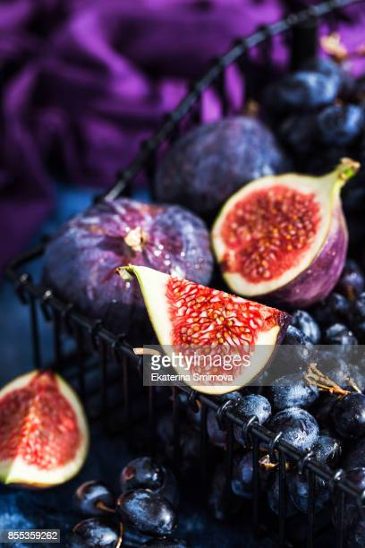 fresh ripe figs and purple grape - juicy stock pictures, royalty-free photos & images