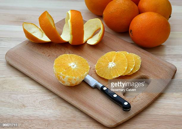 fresh, ripe, juicy orange being sliced. - 皮をむく ストックフォトと画像