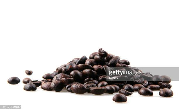 fresh roasted coffee beans isolated on white background - caffeine stock pictures, royalty-free photos & images