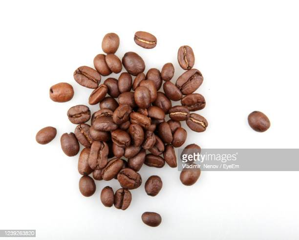 fresh roasted coffee beans isolated on white background - mocha stock pictures, royalty-free photos & images