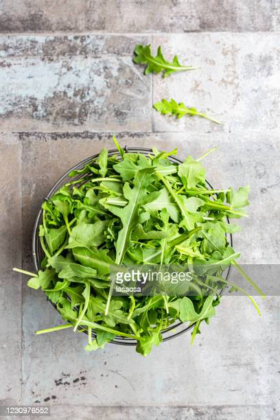 fresh rocket in basket - arugula stock pictures, royalty-free photos & images