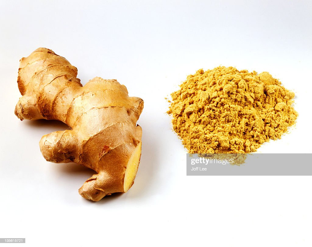 Fresh root ginger with pile of ginger powder : Stock Photo