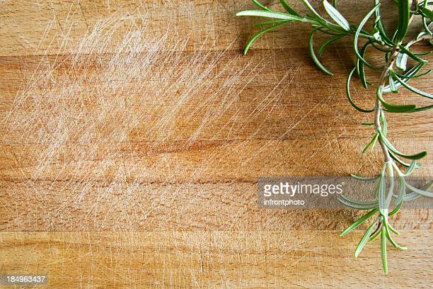 Fresh rosemary on a wood chopping board