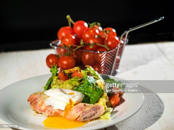 fresh salad and poached egg in plate - igor golovniov stock pictures, royalty-free photos & images