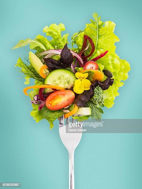 fresh salad on a fork. - salad fotografías e imágenes de stock