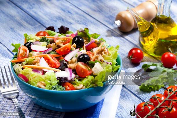 fresh salad plate on blue picnic table - nut food stock pictures, royalty-free photos & images