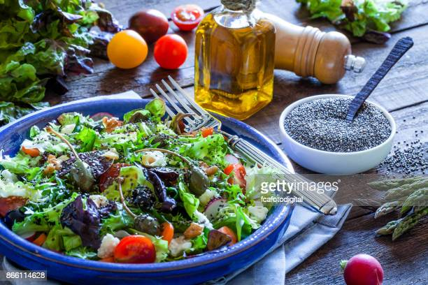 Fresh salad plate on bluish kitchen table
