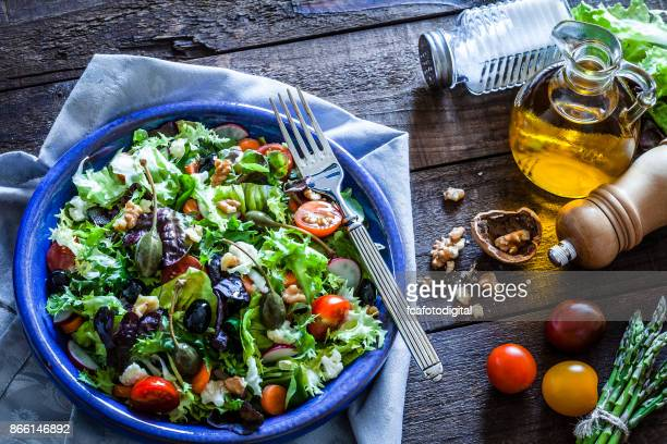 fresh salad plate on rustic wooden table - nut food stock pictures, royalty-free photos & images