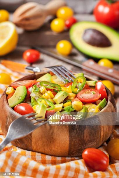 Fresh salad with avocado, corn an? tomato