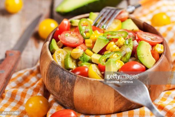 Fresh salad with avocado, corn anв tomato