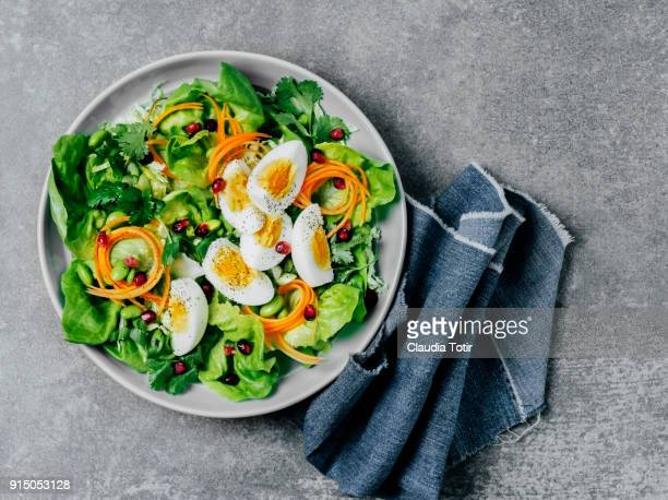 fresh salad with boiled eggs - hard boiled eggs stock photos and pictures