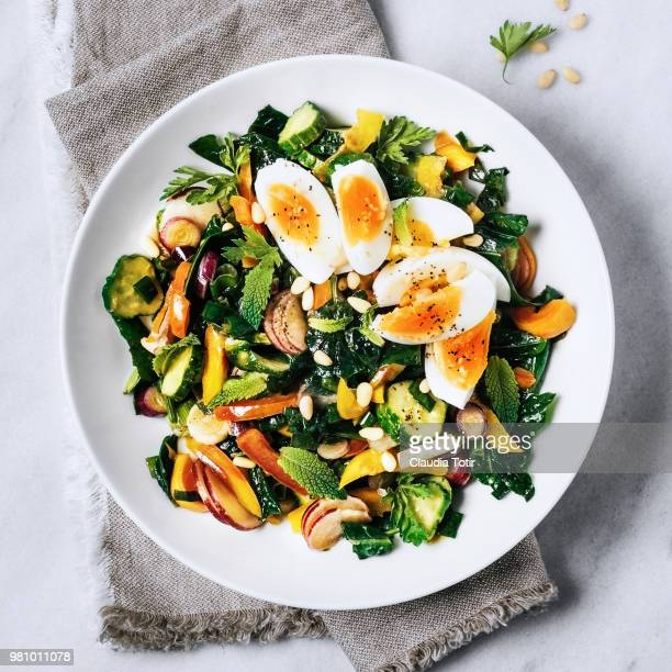 fresh salad with boiled eggs - food stock pictures, royalty-free photos & images