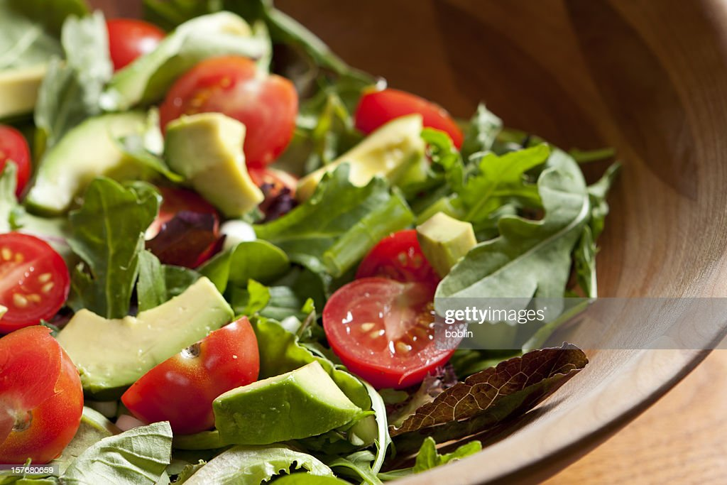 Fresh salad with cherry tomatoes, avocado and mixed greens : Stock Photo