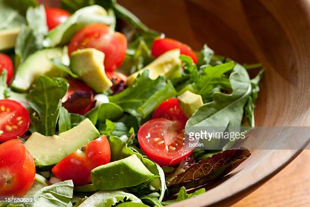 fresh salad with cherry tomatoes, avocado and mixed greens - green salad stock pictures, royalty-free photos & images