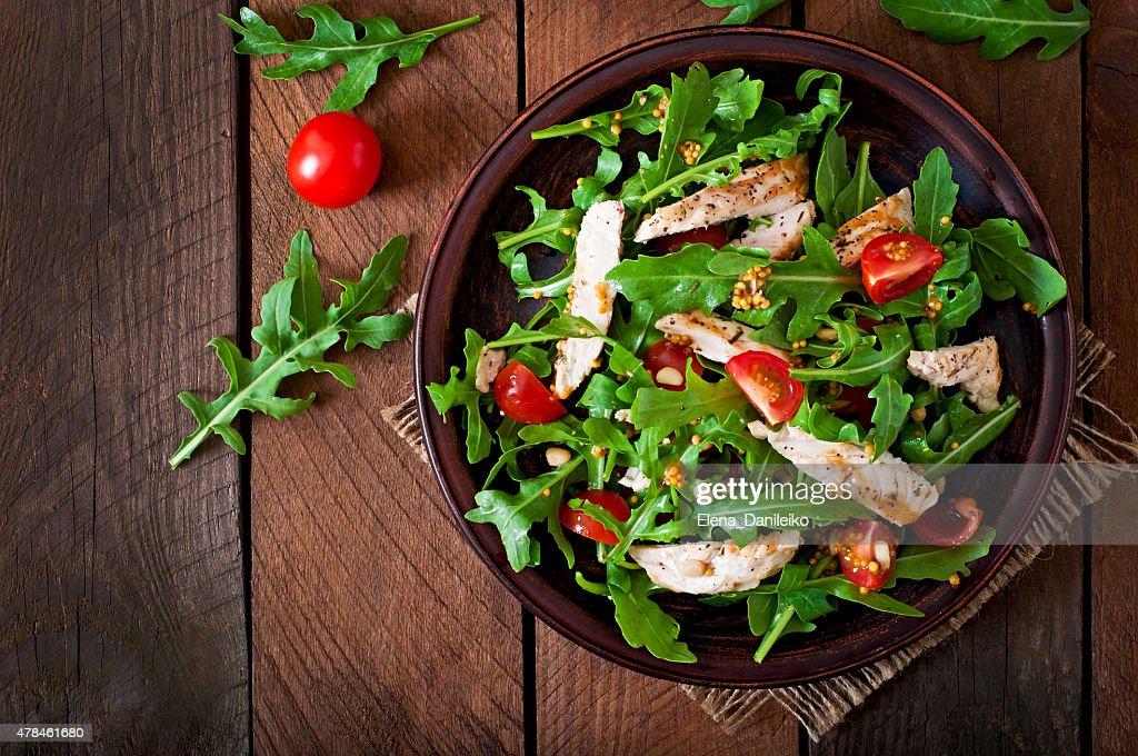 Fresh salad with chicken breast, arugula and tomato : Stock Photo
