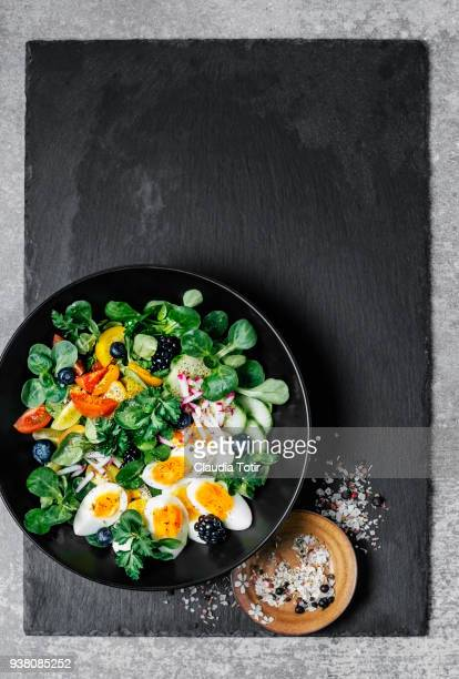 fresh salad with eggs - hard boiled eggs stock photos and pictures