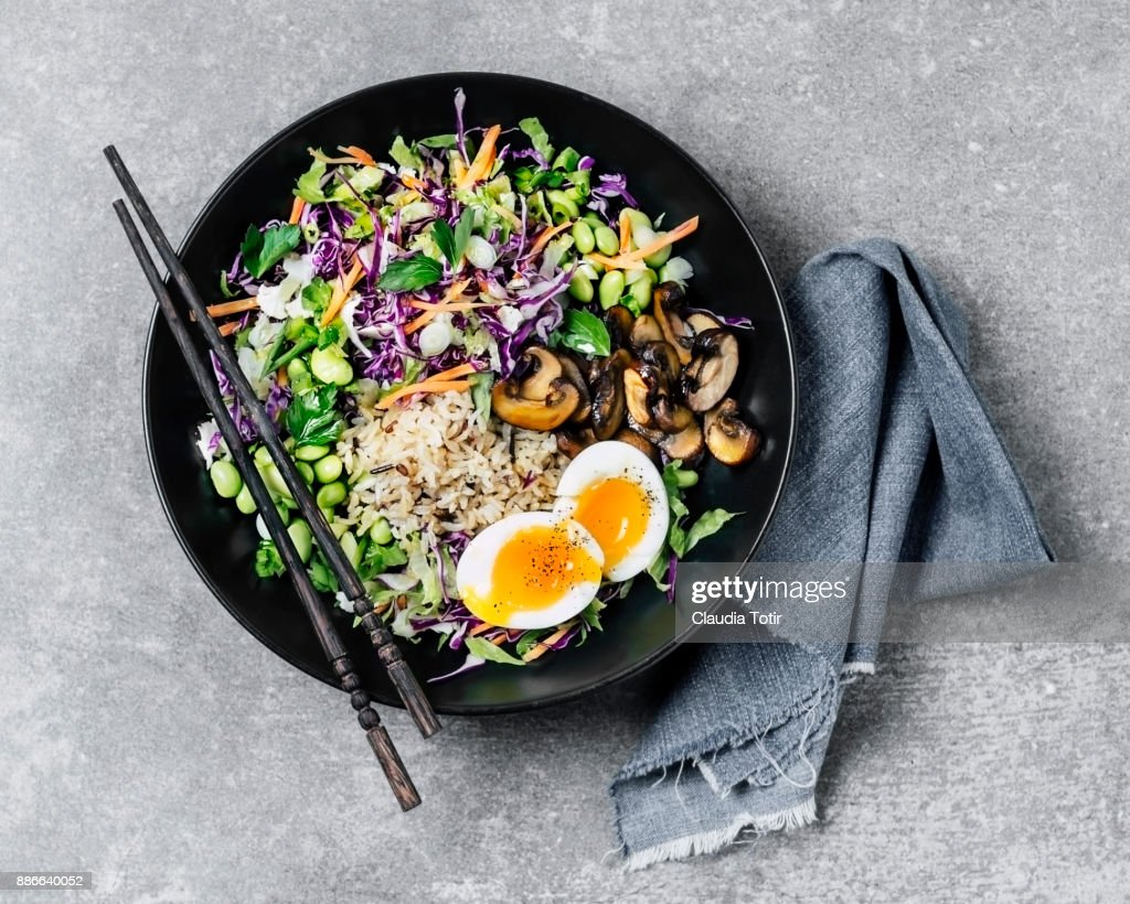 Fresh salad with fried rice and boiled eggs : Stock Photo