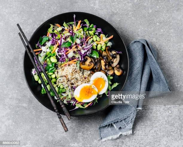 fresh salad with fried rice and boiled eggs - image stock pictures, royalty-free photos & images