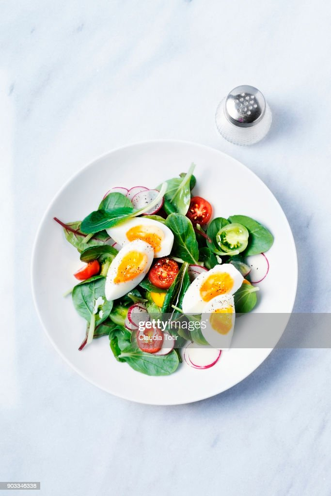 Fresh salad with hard boiled eggs : Stock Photo