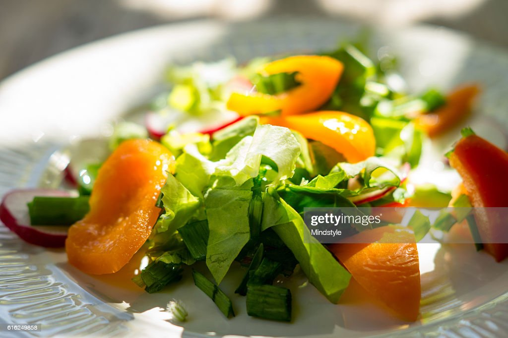 Fresh salad with summer vegetables on the wooden table : Stock Photo