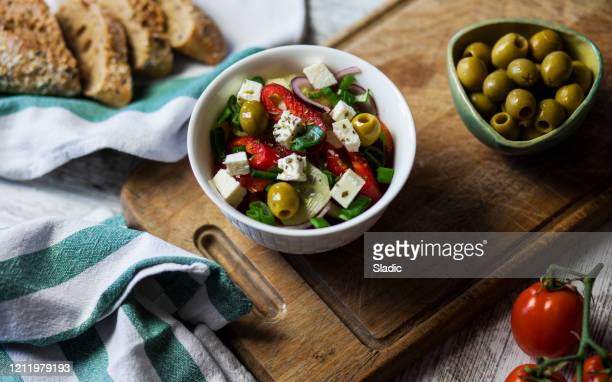 fresh salad,olives and homemade bread - green olive fruit stock pictures, royalty-free photos & images